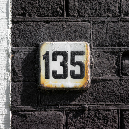 thirty five: nameled house number one hundred and thirty five. Stock Photo