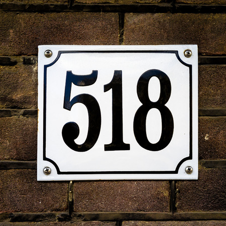 enameled: enameled house number five hundred and eighteen