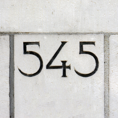 thee: house number five hundred and forty five, carved in stone