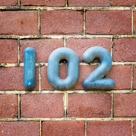 Bronze house number one hundred and two
