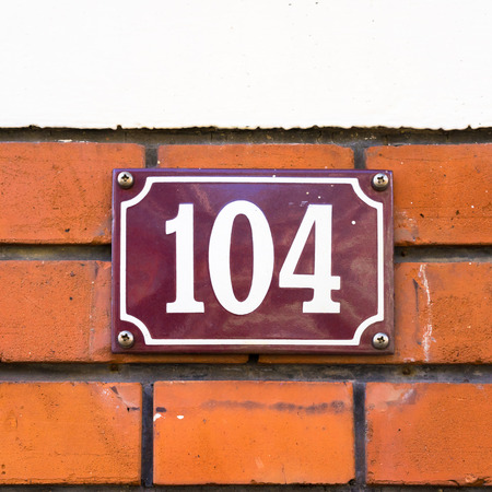 four in one: enameled house number one hundred and four