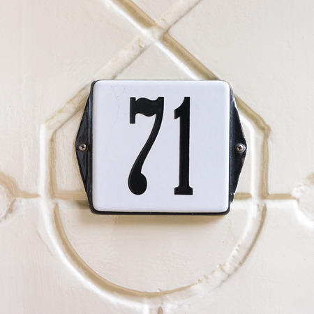 signage outdoor: enameled house number seventy one