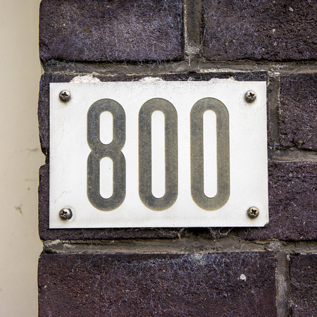 numerals: house number eight hundred. Black numerals on a white background Stock Photo