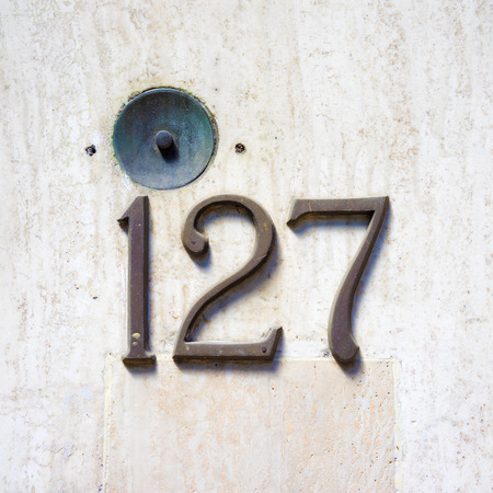 cast metal type: bronze house number one hundred and twenty seven