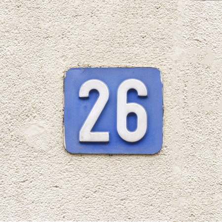 numerals: house number twenty six, white numerals on a blue background