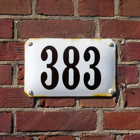 enameled: enameled house number three hundred and eighty three Stock Photo