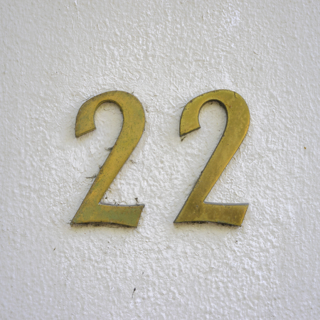 Bronze house number twenty two. Stock Photo