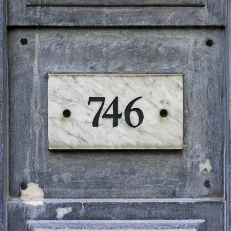 signage: house number seven hundred and forty six, engraved in a marble plate Stock Photo