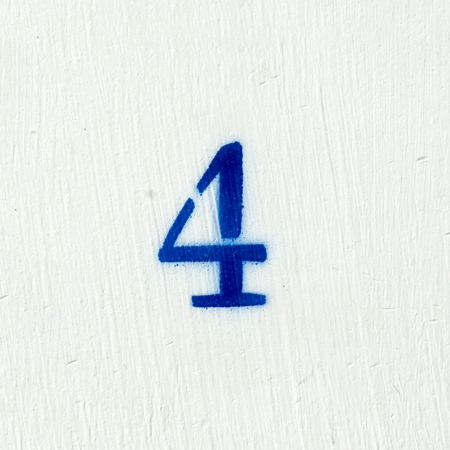Spary painted house number four o a white background