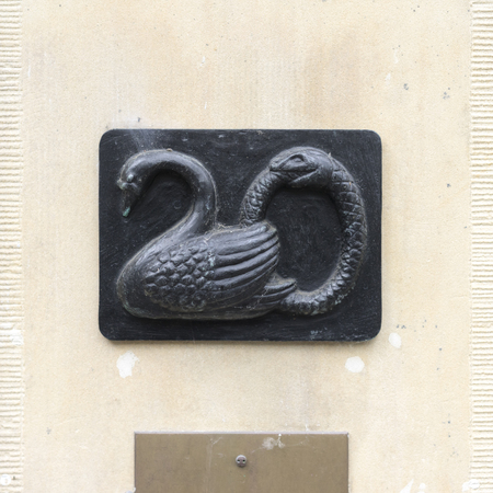 signage: House number twenty in the shape of a swan.