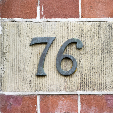 cast metal type: Bronze house number seventy six.
