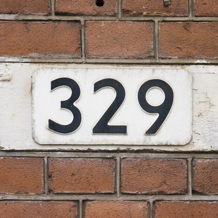 signage: House number three hundred and twenty nine.