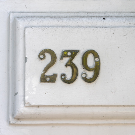 cast metal type: brass house number two hundred and thirty nine (239)
