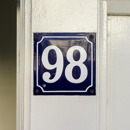 ble: enameled house number ninety eight. Stock Photo