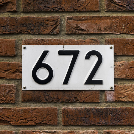 seventy two: House number six hundred and seventy two, embossed in a metal plate.
