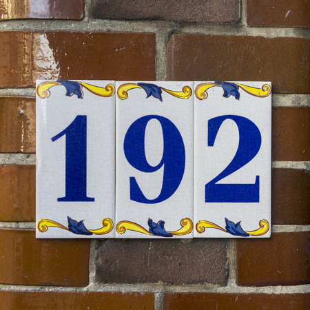 signage: ceramic house number one hundred and ninty two
