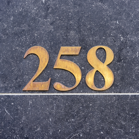 cast metal type: Brass house number two hundred and fifty eight (258) Stock Photo
