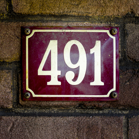 four in one: enameled house number four hundred and ninety one.