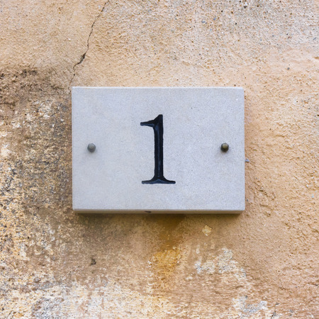 signage: house number one engraved in natural stone Stock Photo