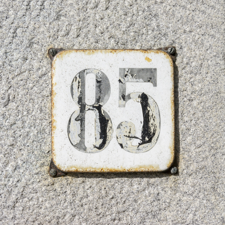 enameled: Enameled house number eighty five.