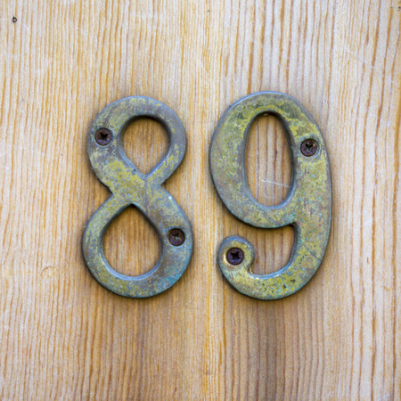 cast metal type: Metal house number eighty nine Stock Photo