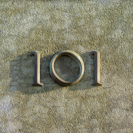 cast metal type: Bronze house number one hundred and one Stock Photo