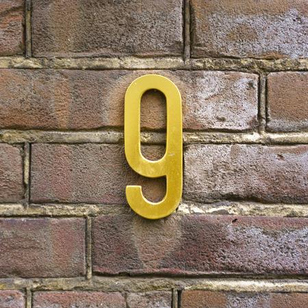 signage: brass house number nine Stock Photo