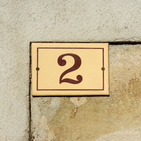 numerals: Enameled house number two. Brown numerals Stock Photo