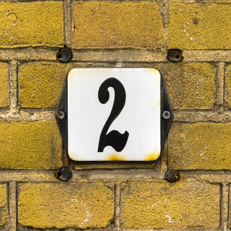 signage: Enameled house number two.