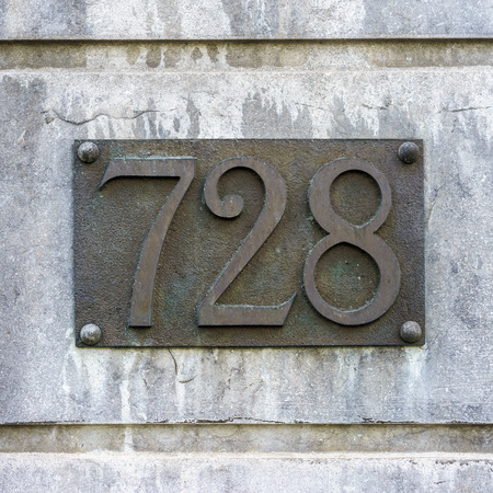 cast metal type: bronze house number seven hundred and twenty eight.