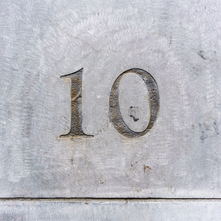 number ten: House number ten engraved in stone