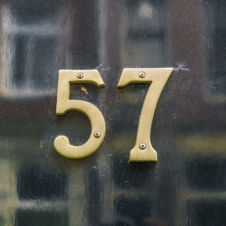 cast metal type: bronze house number fifty seven