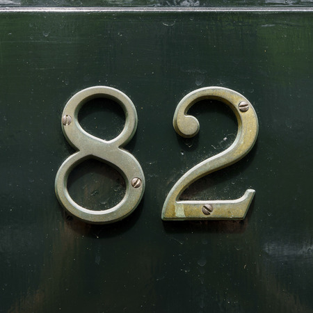 cast metal type: Bronze house number eighty two