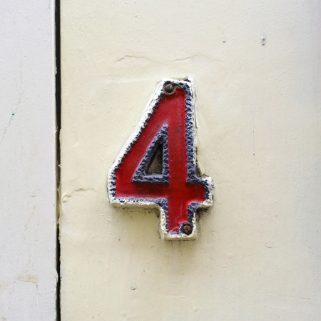 signage outdoor: ceramic house number four Stock Photo