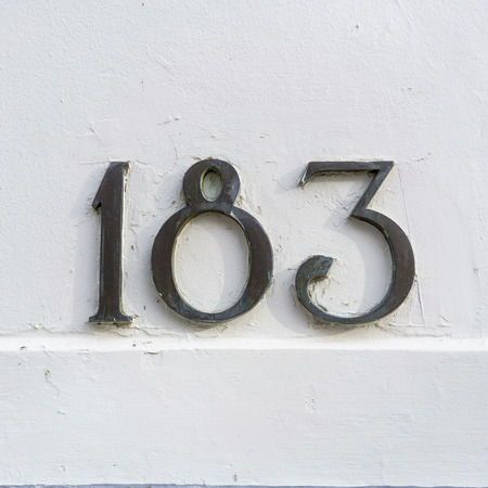 cast metal type: Bronze house number one hundred and eighty three