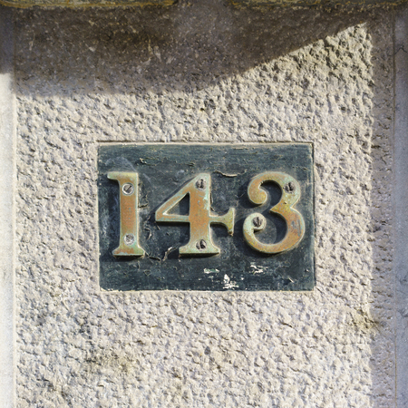 cast metal type: bronze house number one hundred and forty three