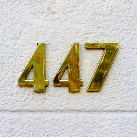 cast metal type: Golden house number four hundred and forty seven