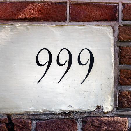triplet: House number nine hundred and ninety nine Stock Photo