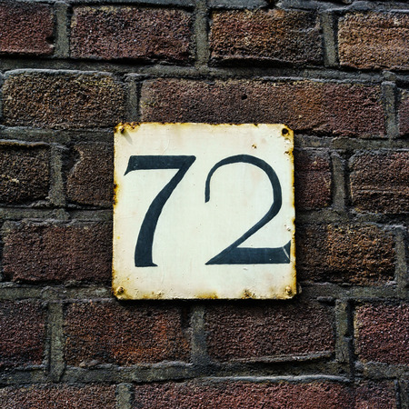 seventy two: House number seventy two on a rusty plate