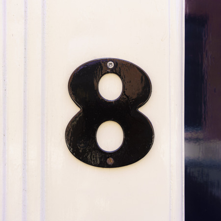 eight: Lacquered house number eight