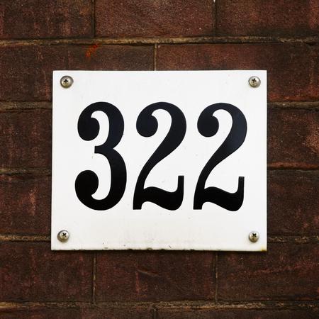 twenty two: Enameled house number three hundred and twenty two.