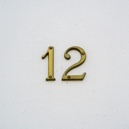 Ordinal: Brass house number twelve Stock Photo