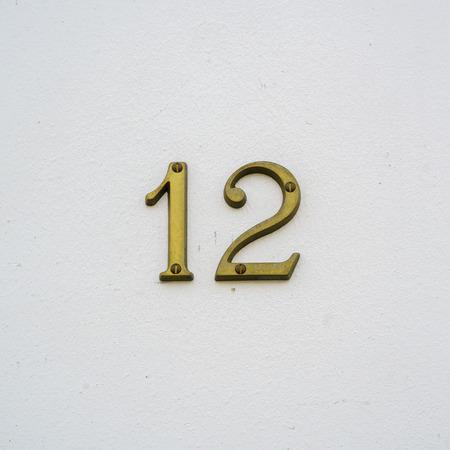 Brass house number twelve Stock Photo