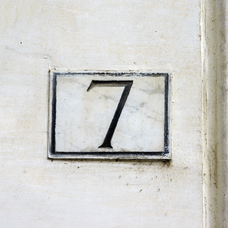 Ordinal: House number seven engraved in marble