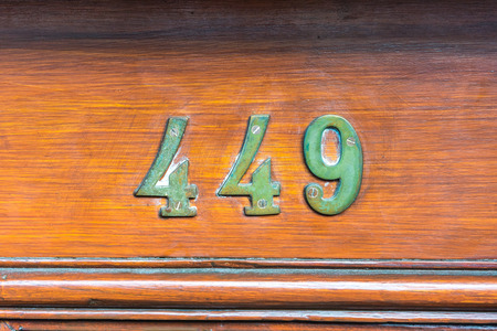 cast metal type: Bronze house number four hundred and forty nine (449) Stock Photo