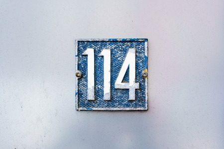 cast metal type: House number one hundred and fourteen