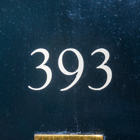 impacciato: clumsy template painted house number three hundred and ninety three Archivio Fotografico
