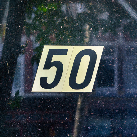 50 number: skewed house number fifty (50) Stock Photo