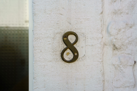 Brass house number eight