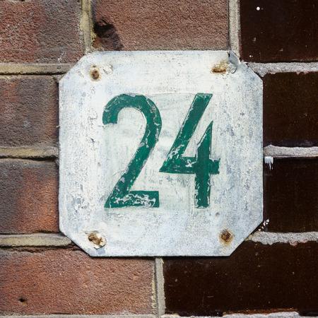 twenty: Hand painted house number twenty four (24) Stock Photo